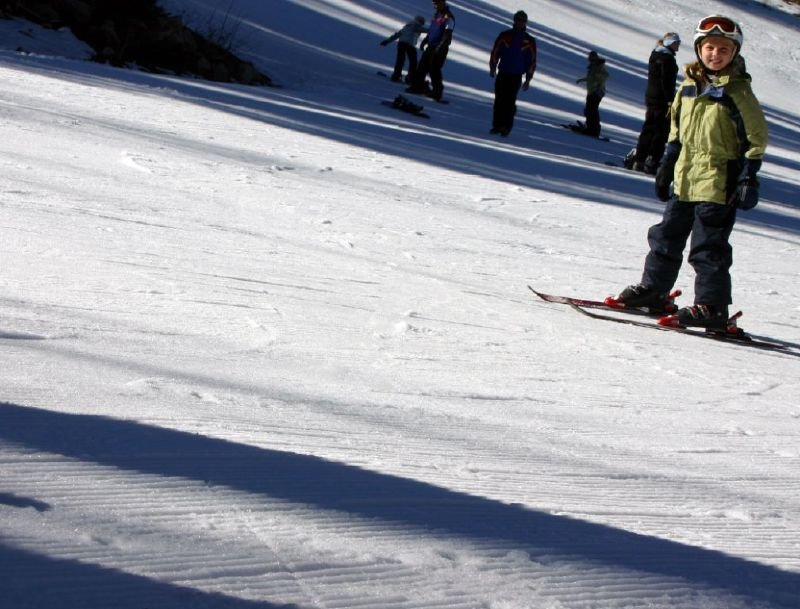 A kid smiles while skiing at Solitude Mountain Resort, Utah