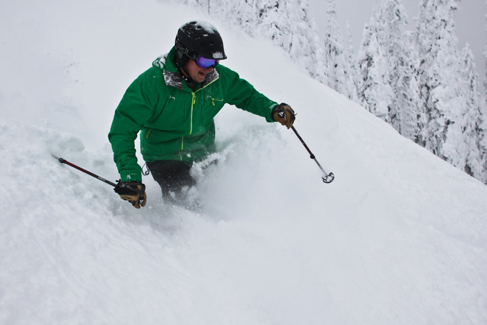 A skier sinks into powder at Whitefish Mountain Resort. Photo courtesy of Whitefish Mountain Resort.