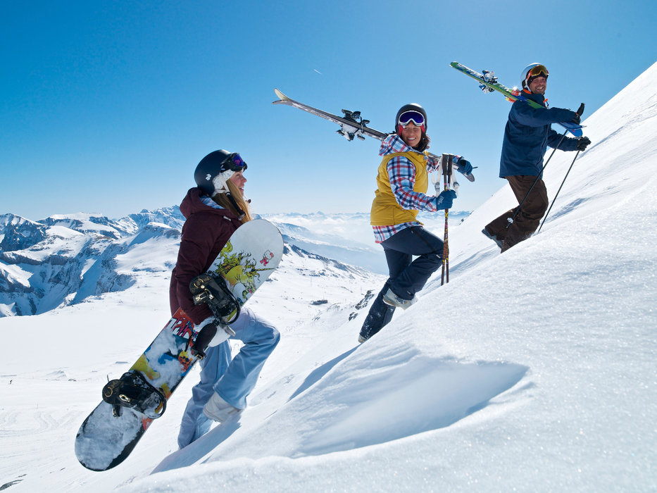 Skiers and snowboarders in Laax