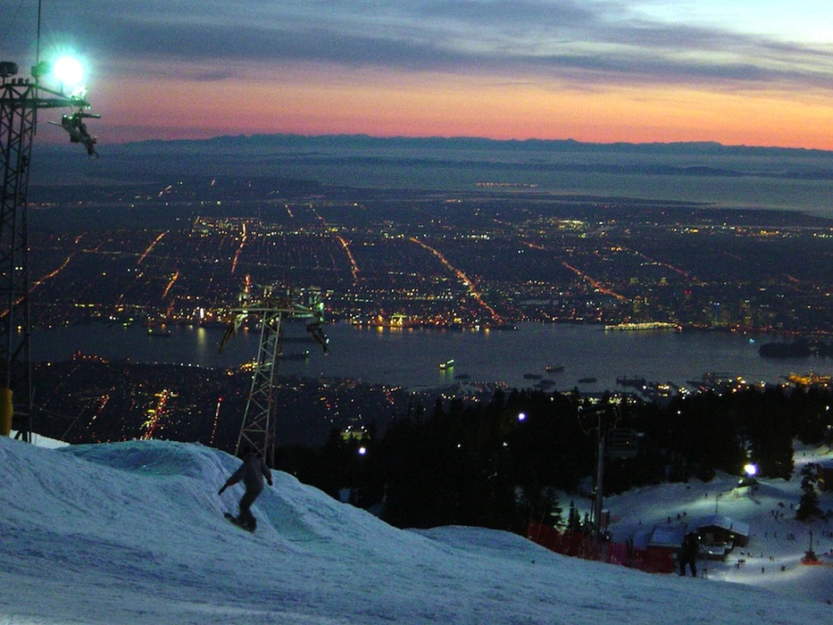 Sunset at Grouse Mountain above the lights of Vancouver. Photo by Hiroki Nakamura/Flickr.