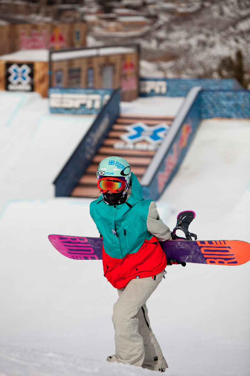 Snowboard slopestyle practice. The course features jumps, rails, and boxes.