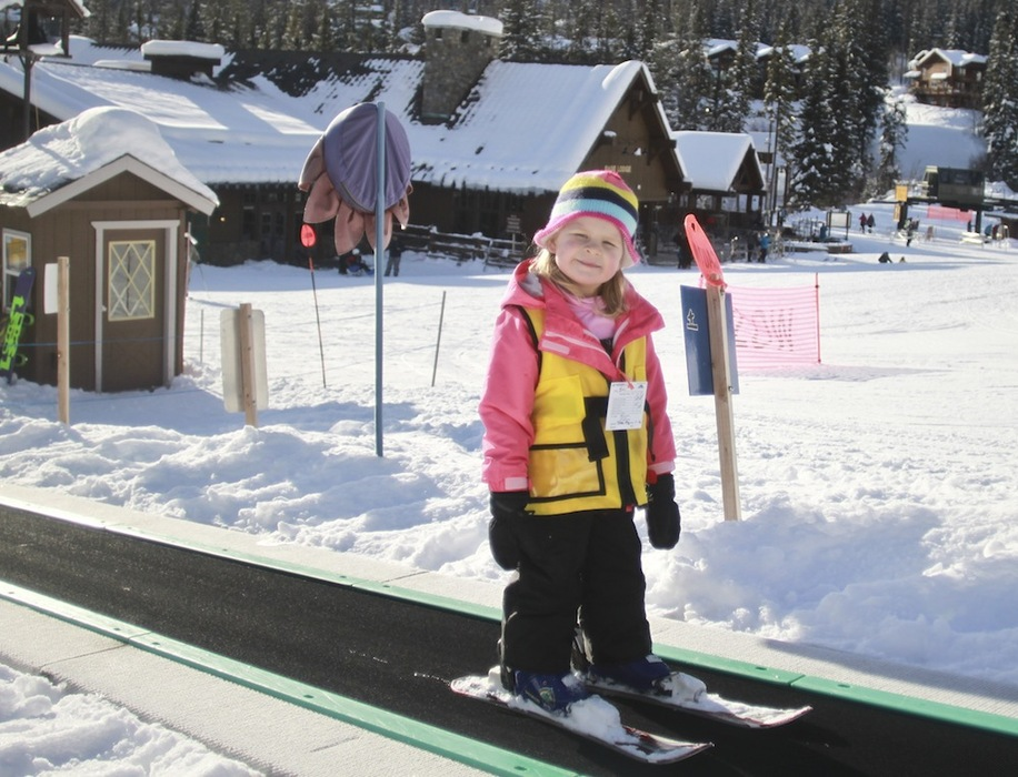 A young skier rides the Magic Carpet at Whitefish Mountain Resort.Photo courtesy of Whitefish Mountain Resort.