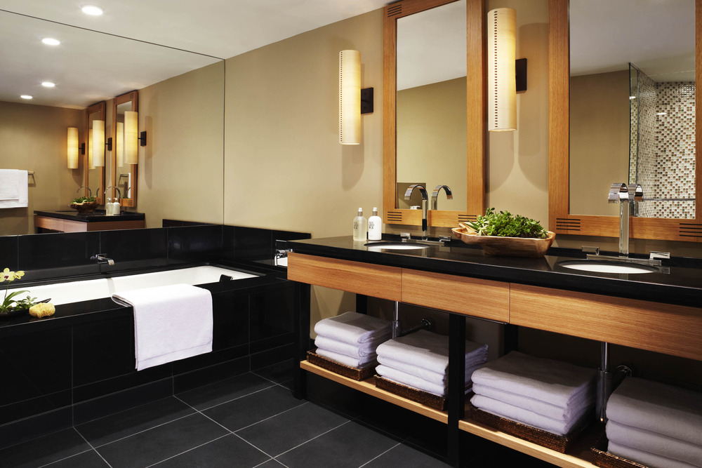 The five-piece bathrooms have black marble flooring, black granite countertops for the dual vanity and oversized soaking tubs.