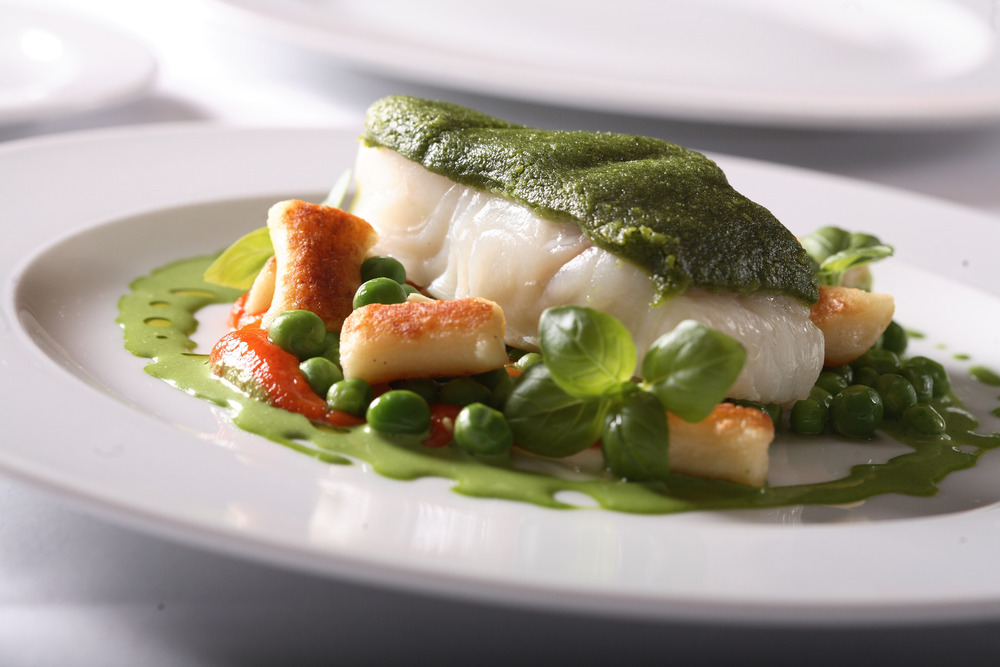 Basil crusted sablefish with fresh peas and house-made gnocchi. Just one of the dishes at Araxi.