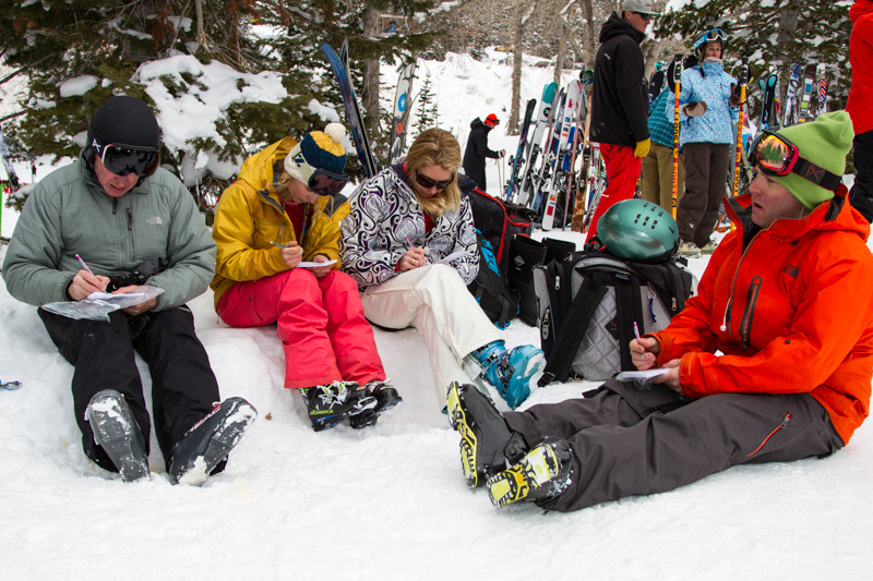 Caroline Gleich and other testers fill out their test cards after ripping up Snowbird.
