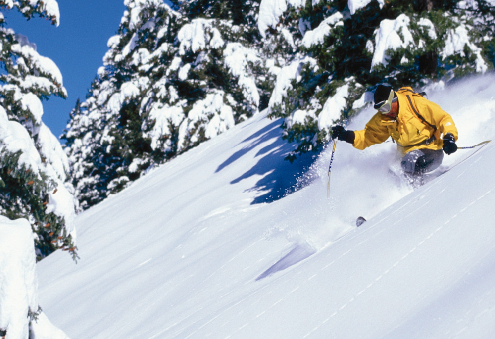 Sinking in on a bluebird day at Moonlight.Photo courtesy of Moonlight Basin. 