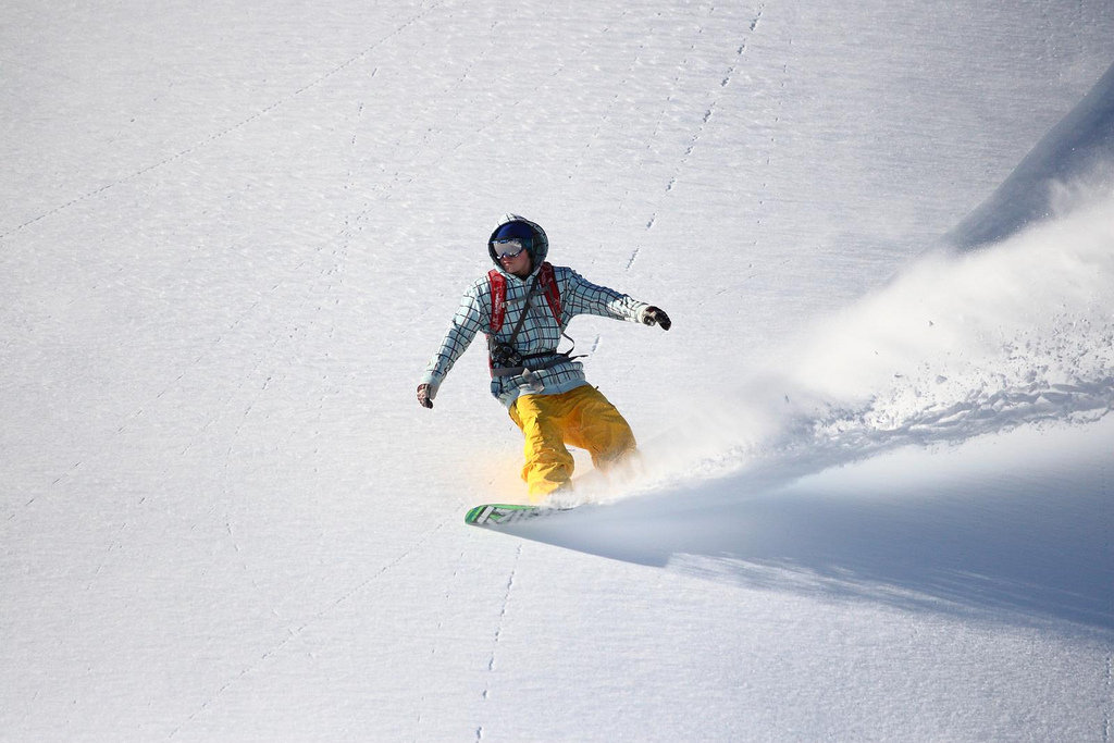 A snowboarder slices a powdery slope at Mt. Baker. Photo by Judd Hall/Flickr.