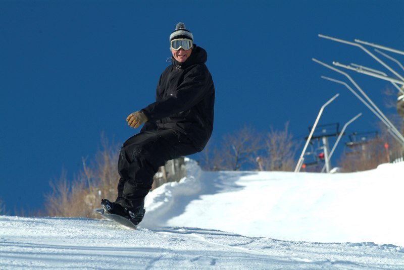 A snowboarder cruises down Hunter Mountain, New York