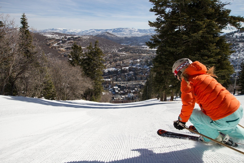 Park City local and retired pro skier Meghan Brown rips it up at Park City Mountain Resort. From several groomers on the mountain you can see town down below.