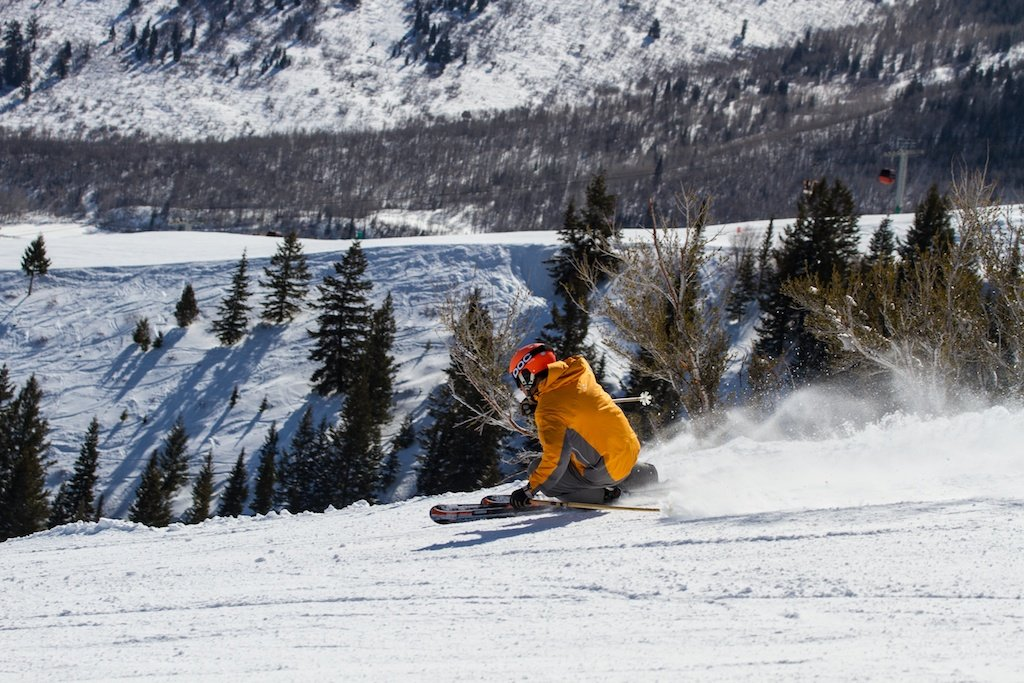 Former World Cup Alpine Ski Racer Erik Schlopy rips up a groomer at Canyons in Park City, Utah. - ©Liam Doran