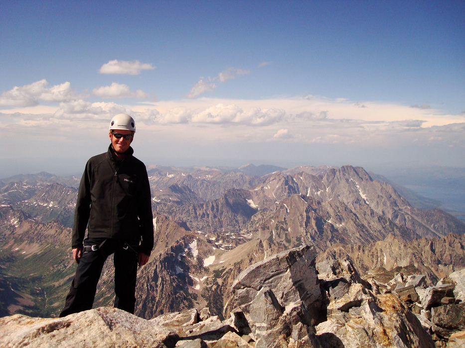 Standing on the summit of the Grand Teton.