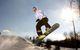 A snowboarder gets air in the terrain park, Shanty Creek Resorts, Michigan