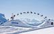 Freestyle snowboarder tricks at Kronplatz Snowpark, Austria,
