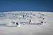 Group turns underneath the chopper at Tyax Lodge Heli-Skiing. - ©Randy Lincks/Andrew Doran