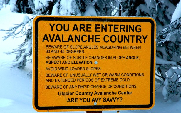 At Whitefish Mountain Resort, signs at ski area boundary exits remind backcountry travellers of safety concerns. - ©Becky Lomax