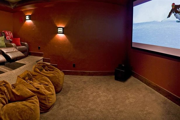 Amenities like in-home movie theaters really set Moving Mountains' luxury properties apart.