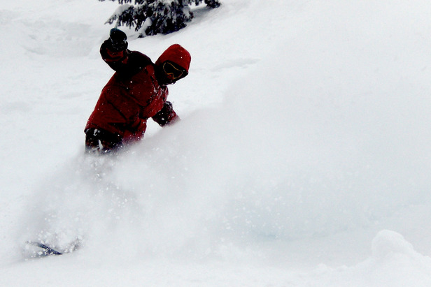 A snowboarder sinks into Grand Targhee powder. Photo by Rob Baird/Flickr. - ©Rob Baird/Flickr