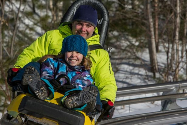 A father and daughter ride the mountain coaster at Cranmore. Photo Courtesy of Cranmore Mountain Resort.