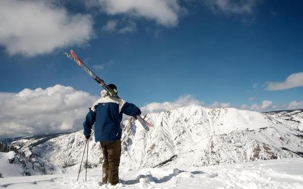 A skier admiring the tremendous views of the Sierra Mountains at Bear Valley.
