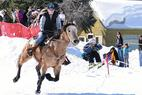 Skijoring makes its way through downtown Silverton, Colo. during the annual Silverton Ski-Joring event. - Skijoring makes its way