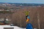Hitting rainbow rails with the town of Wasau in the background at Granite Peak. - Hitting rainbow rails with