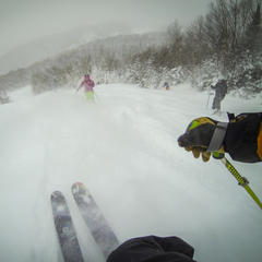 A pack of skiers bomb around Mont Tremblant on a powder day.