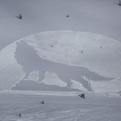 Snow Art Gallery: Howling Wolf by Simon Beck at Lake Louise