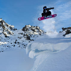 A snowboarder grabs cornice air at Mt. Bachelor. Photo by Tyler Roemer.