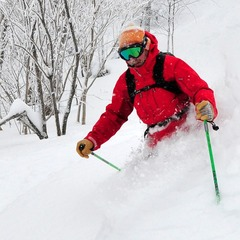 A skier blasts through waist-deep pow at Mad River Glen - ©Mad River Glen