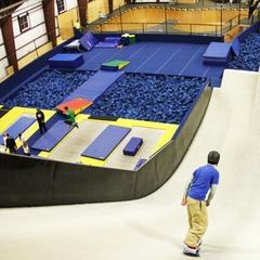 A snowboarder rides down the Snowflex ramp towards the foam pit in the Woodward Barn. Photo Courtesy of Woodward at Copper.