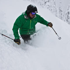 A skier sinks into powder on opening day at Whitefish Mountain Resort. Photo courtesy of Whitefish Mountain Resort.