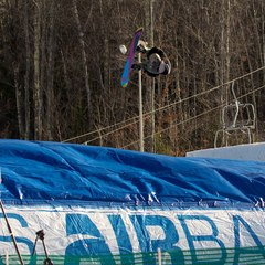 A snowboarder practices flips onto the airbag at Crotched Mountain. Photo Courtesy of Crotched Mountain. 