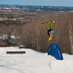 Hitting rainbow rails with the town of Wasau in the background at Granite Peak.