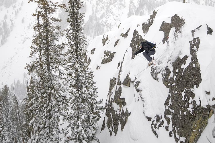 A skier drops in off a cliff in the backcountry at Jackson Hole Mountain Resort, Wyoming - © Jackson Hole