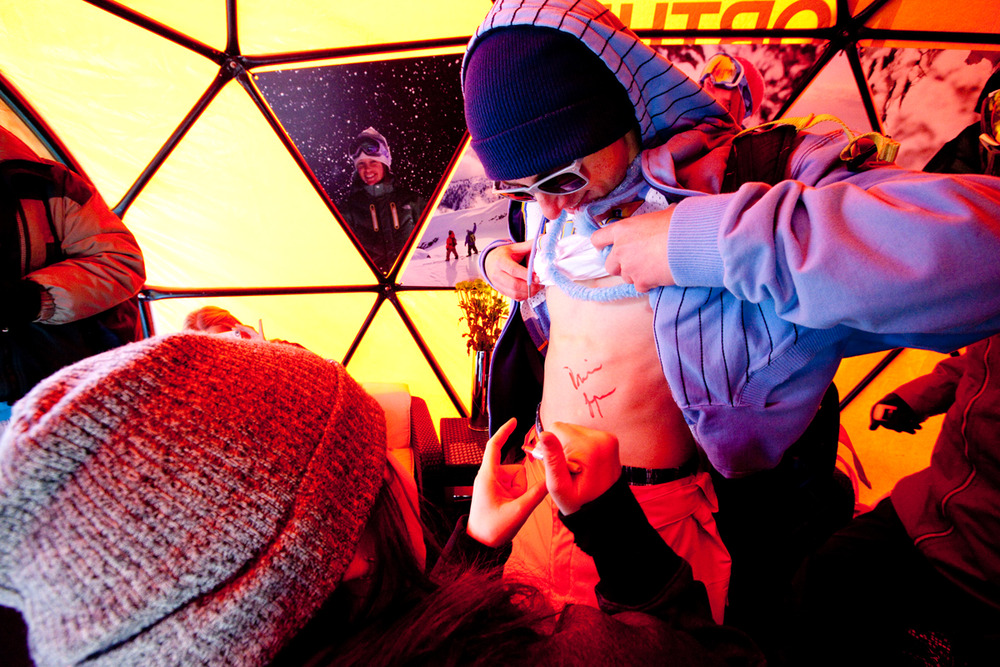 Devin Logan signs a fan's stomach in the North Face tent. Photo by Sasha Coben