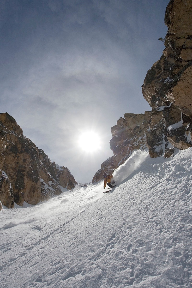 Zach Crist skiing the lower half of the Heyburn Couloir in perfect powder conditions. Photo by Will Wissman