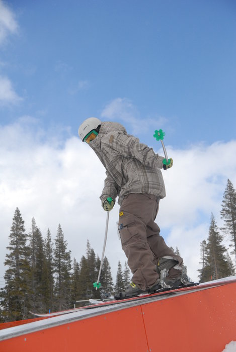 A skier shows off a trick at the terrain park at Sugar Bowl Ski Resort, California