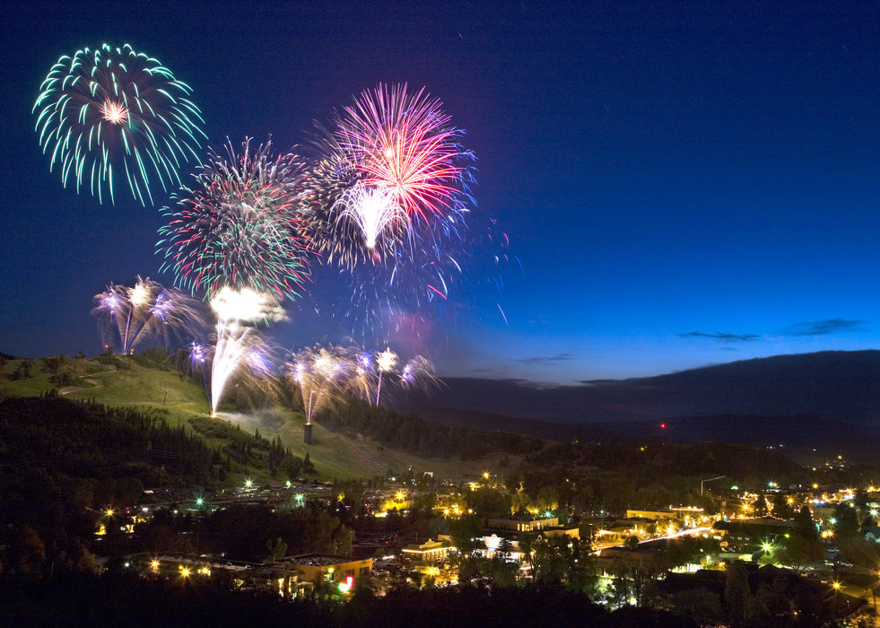 Fireworks shoot up over Howelsen Hill and the city of Steamboat Springs.  - © Corey Kopischke