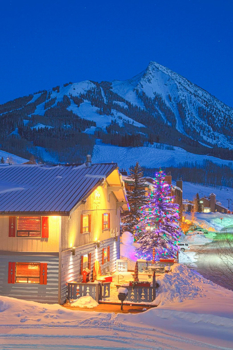 Mt. Crested Butte lights up with winter cheer. - © Courtesy of Nordic Inn/Nathan Bilow