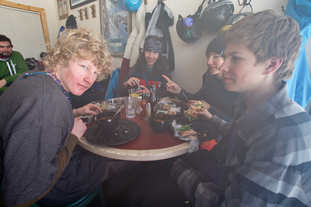 Ian Borgeson (left) and the young kid crew enjoy a lunch of smoked salmon, tomato bisque, and salad during lunch. Photo by Liam Doran