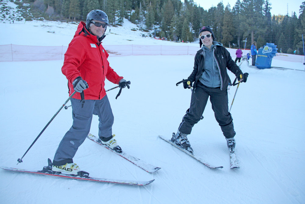 Ski instructor, Gary Cox, and guest hit the slopes of Homewood during January's Learn to Ski or Ride Month.  - © Paul Raymore, Homewood Mountain Resort