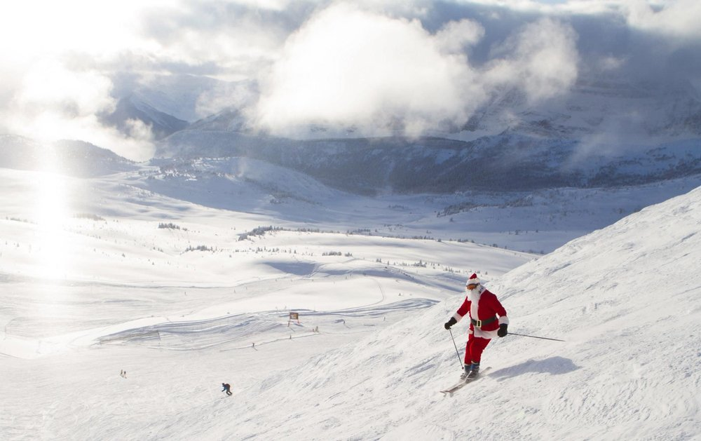 Santa making some turns in the big open bowl. - © Sunshine Village Resort