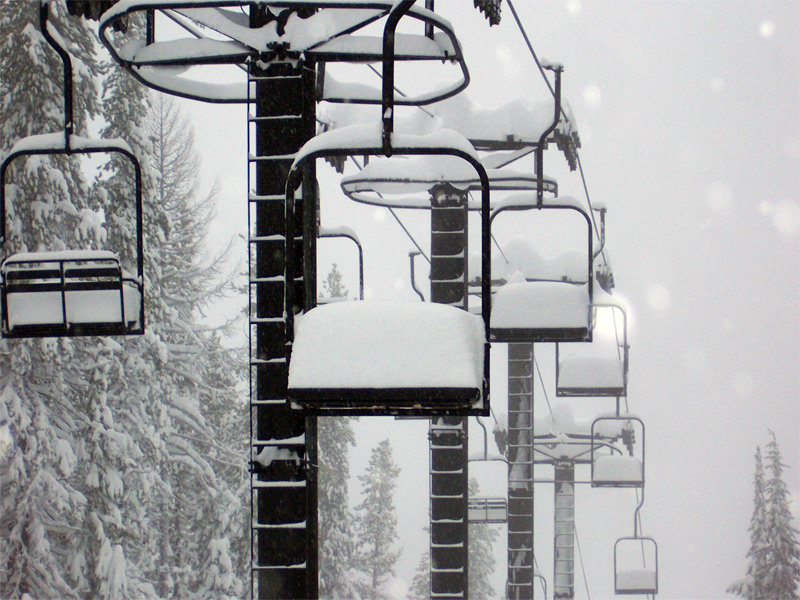 Chair lifts covered in snow at Lookout Pass Ski Area, Idaho