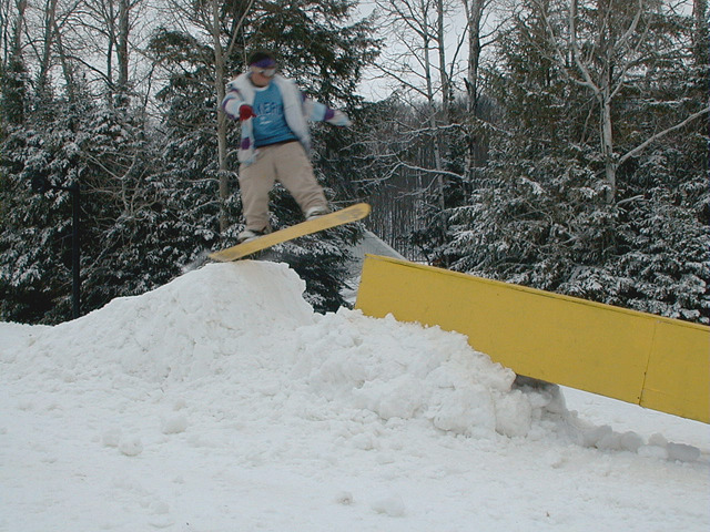 A snowboarder hits a rail in the terrain park in Ski Brule, Michigan