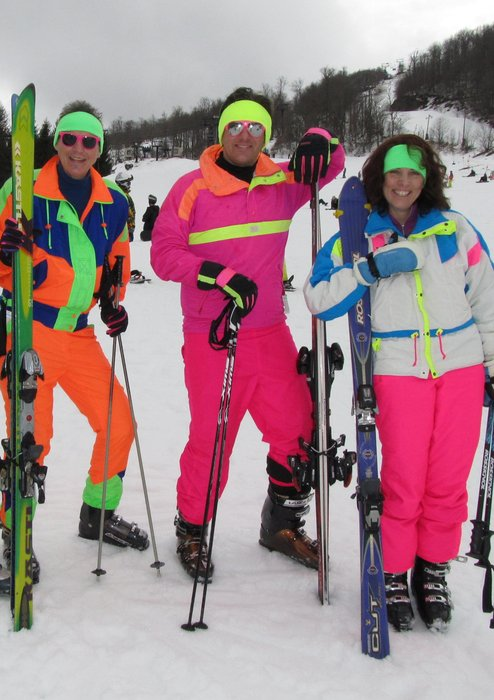 Neon-clad skiers at Beech Mountain. - © Beech Mountain Resort