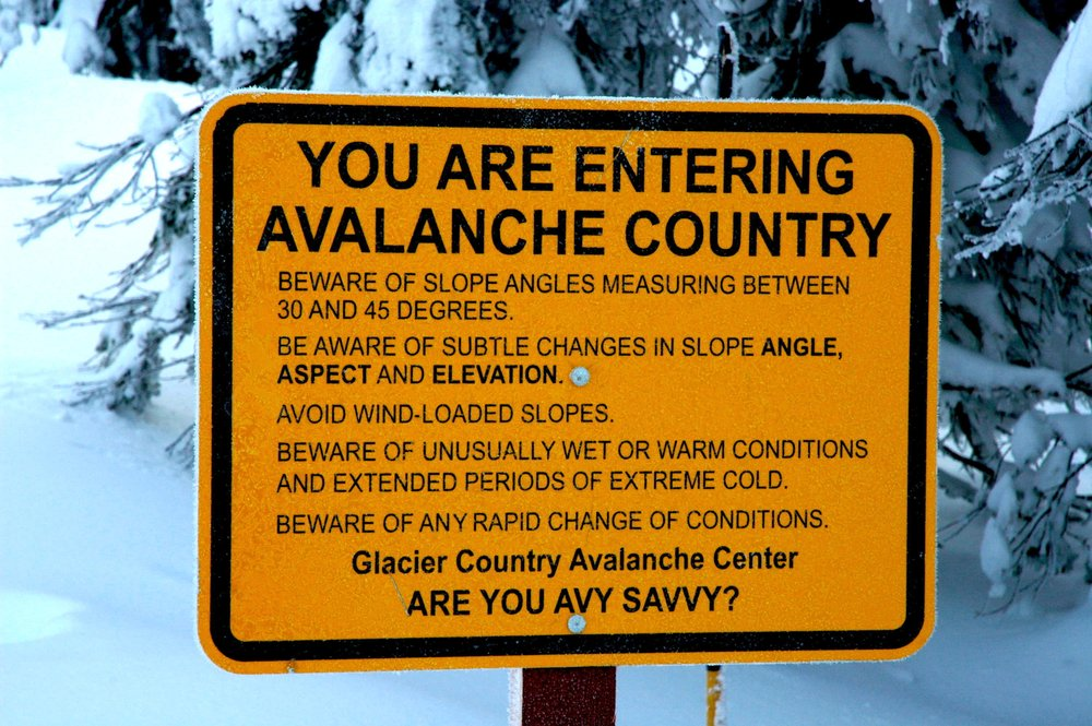 At Whitefish Mountain Resort, signs at ski area boundary exits remind backcountry travellers of safety concerns. - © Becky Lomax