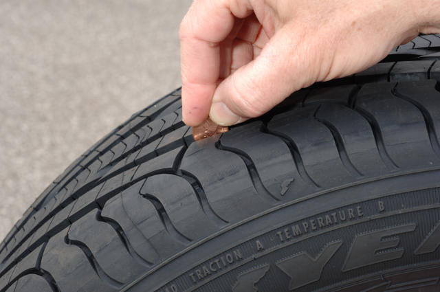 Consumers can regularly check the remaining tread depth of their tires with this simple test. Place a penny in the tread with Lincoln's head upside down and facing you. If you can see the top of Lincoln's head, it is time to replace your tires. - © Goodyear