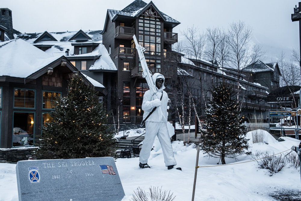 This 2,200-pound, 13-foot bronze statue at Stowe's base commemorates soldiers of the 10th Mountain Division ski infantry. - © Liam Doran
