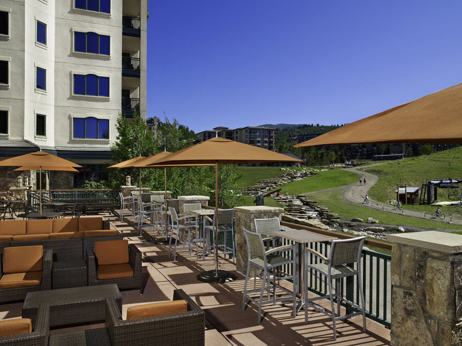 The deck at Saddles Bar & Grill is a great spot to take in the view, summer or winter. - © Sheraton