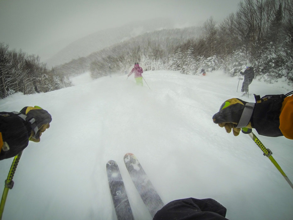 A pack of skiers bomb around Mont Tremblant on a powder day. - © Tremblant